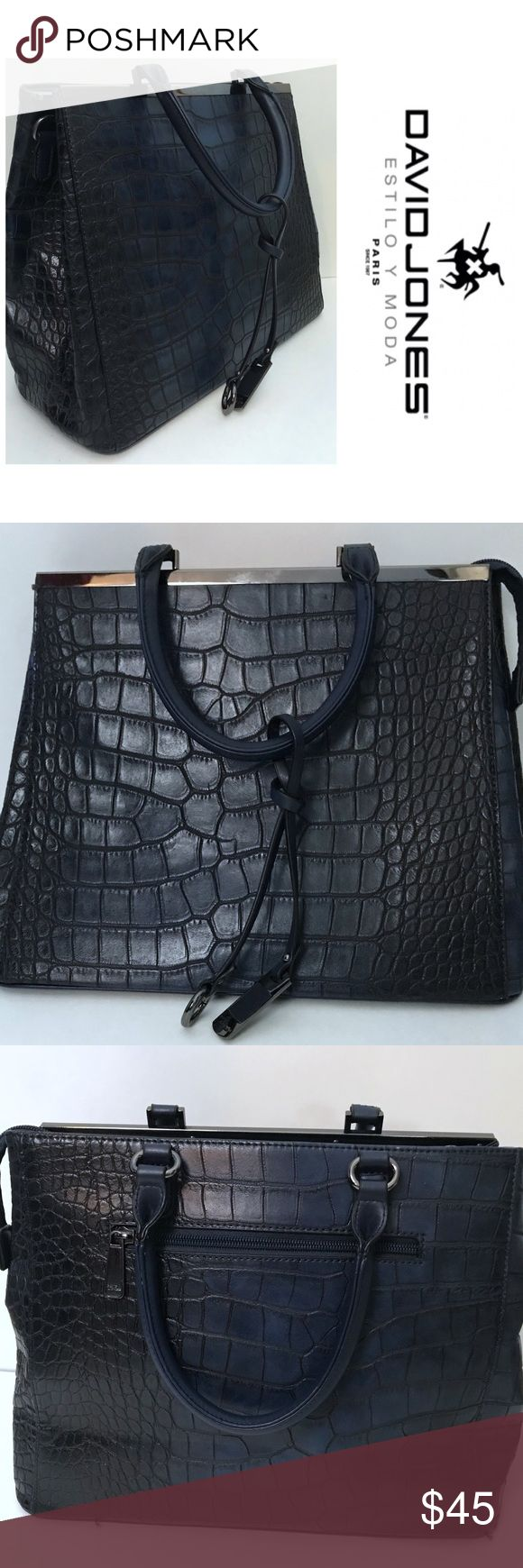 David Jones Navy Blue Faux Alligator Handbag This lovely navy blue David Jones Paris handbag is in excellent condition. Exterior is Navy Blue with silver details, while the interior is a tan color. One exterior zipper pocket, two interior zipper pockets, and two additional pockets. Large interior. David Jones Paris Bags