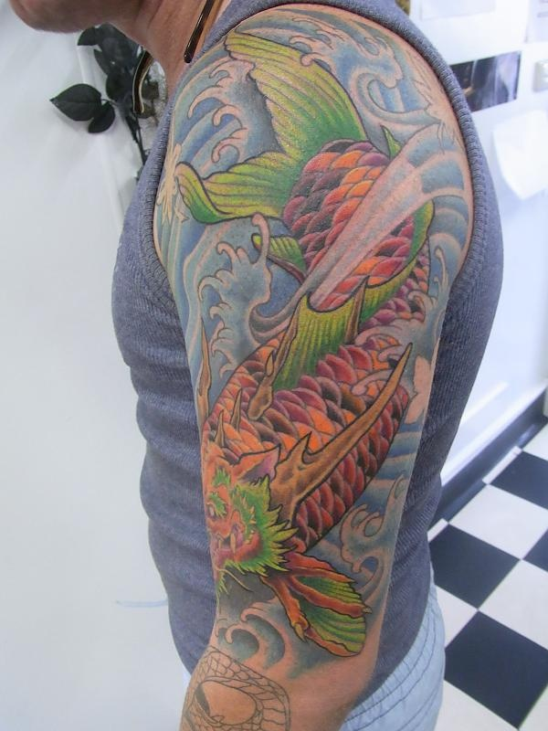 1000 images about koi tattoos on pinterest leeds back for Black dragon koi