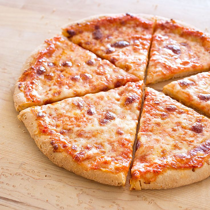 Most gluten-free pizza tastes like wet cardboard. By examining every detail, we eventually came up with a crust that's crispy outside and light and airy inside.