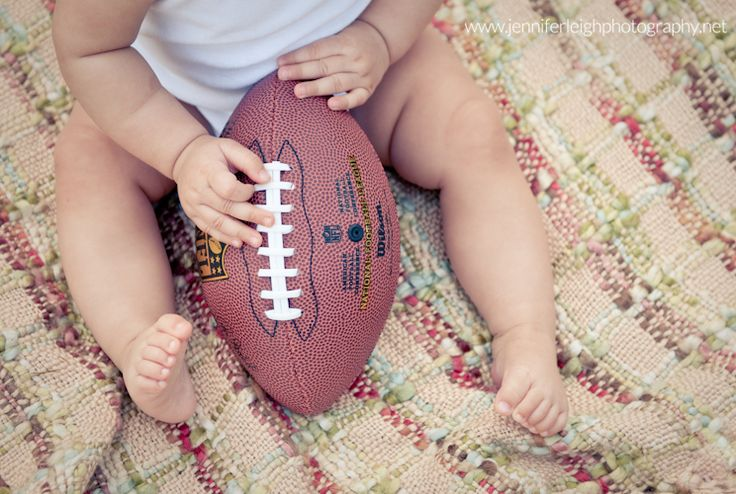 First Football Season for Baby! Professional photographer and new mom, Jennifer Tacbas, dressed up her daughter for a football stylized shoot to celebrate her baby's first football season. Enjoy these pictures, and let them inspire you to take your own football themed baby portraits!