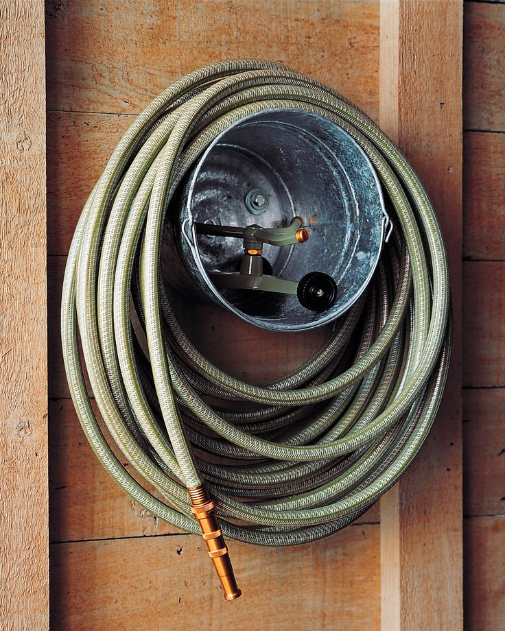 Bucket Hose Storage | Martha Stewart Living - A galvanized paint bucket makes a practical and inexpensive caddy for a garden hose and sprinkler. Drill three holes in a triangular pattern in the bottom of the bucket.