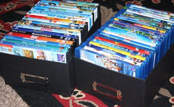 Use standard photo storage boxes to store DVDs - and you can even sort and label them easily!