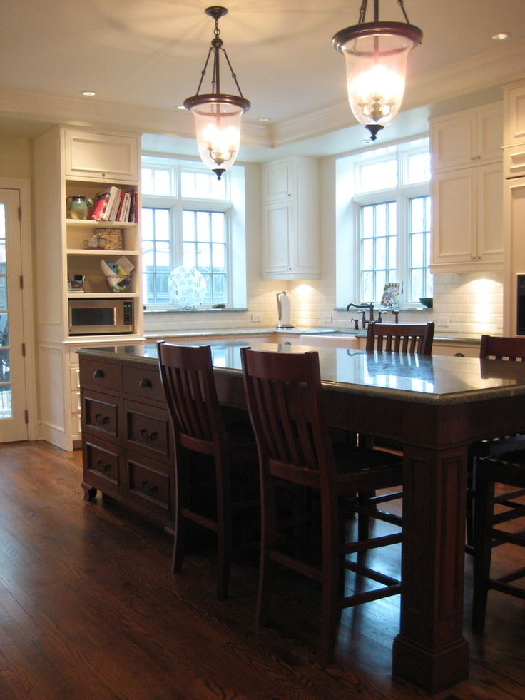 kitchen island with seating for 4 pendants brown countertops white cabinets hardwood floors chairs sink subway tile backsplash shelves traditional design of Fabulous Islands to See If You Want a Kitchen Island with Seating for 4