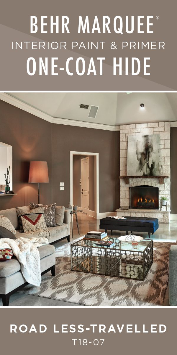 This southwestern style living room feels warm and cozy thanks to the neutral beige hue of Road Less-Travelled by BEHR Paint. BEHR MARQUEE® Interior Paint offers a one-coat coverage guarantee, when tinted to one of over 1,000 color options from the Marquee One-Coat Color Palette and painting over a previously painted surface.  Click here to learn more about BEHR Marquee Interior Paint.