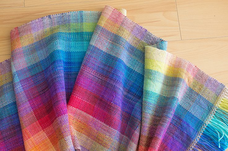 There is a great tutorial for making this gorgeous scarf. Lots of changing colors but so beautiful!. 12-dent heddle and mini sock yarn skeins.