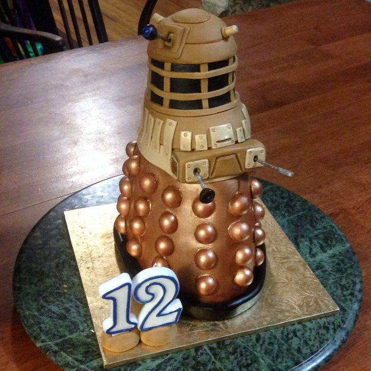 Rigil's 12th Birthday cake It was a Dr Who costume party and he asked for a Darlek cake. It's only 25cm tall but I was very happy with how it turned out.