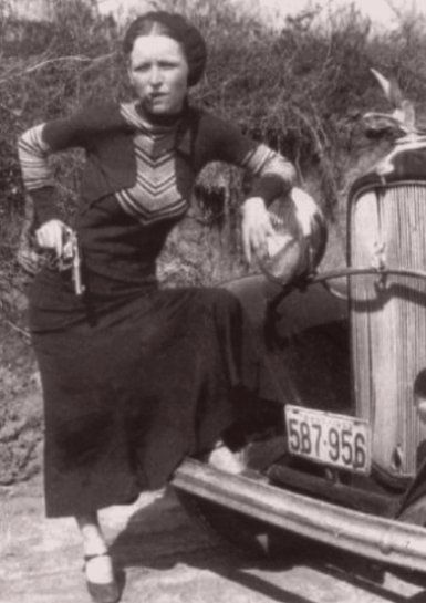 Pistol-packin' Bonnie. Bonnie Parker was not a nice woman. After all, she killed people. Yet she indubitably attracts us, especially in this photograph, leaning against a Depression-era car, holding a gun in her right hand, and chomping down on the cigar in her mouth.