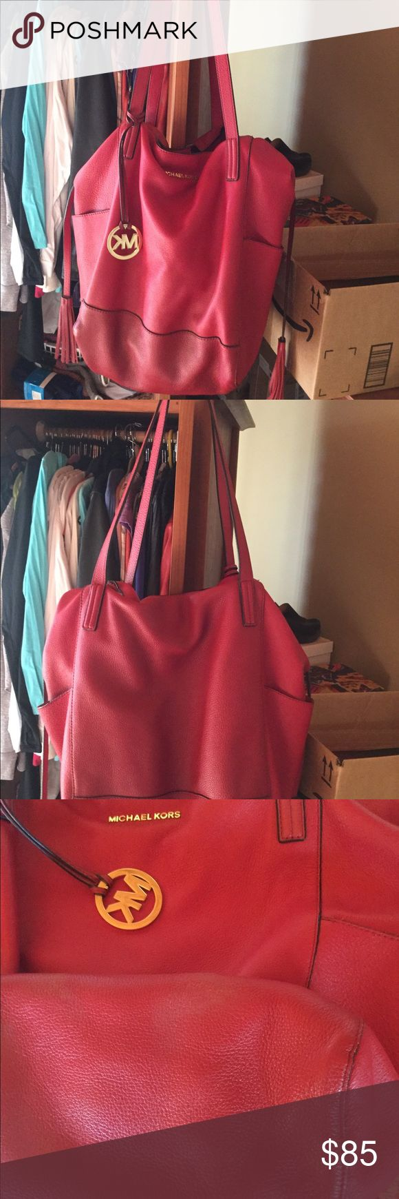 Michael Kors Ashbury Red Handbag Michael Kors Ashbury Large  red handbag. The removable inner pocket has fuzz on it from being washed. On the bottom of handbag has a couple small marks. See in pic. Other than that a beautiful handbag Michael Kors Bags Shoulder Bags