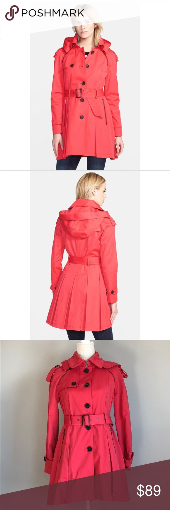 "NWT French Connection Skirted Trench with hood. S Stay dry while looking stylish! Beautiful NWT French Connection trench with a fashionable skirted silhouette flared with box pleats, belt (that can be worn tied), and a removable hood. Tag says the color is red but it is has a tad bit of coral to it. Size Small. Shoulder to front hem: 31.5"" Shoulder to back hem: 34"" Across chest while buttoned: 17"" French Connection Jackets & Coats Trench Coats"