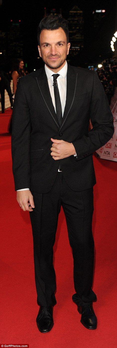 Riding solo: Peter Andre (left) was without his fiancéeEmily MacDonagh as he sported a bl...