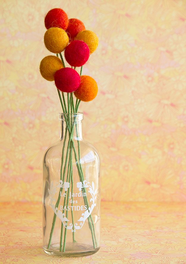 Easy DIY Felt Ball Decor | Felt Ball Flowers by DIY Ready at http://diyready.com/diy-projects-with-felt-balls/ 