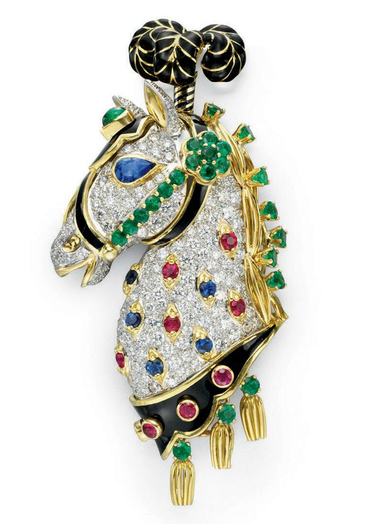A DIAMOND, MULTI-GEM AND ENAMEL BROOCH, BY DAVID WEBB  Designed as a pavé-set diamond carnival horse head, accented by circular-cut ruby, sapphire and emerald detail, with a pear-shaped sapphire eye, and a black enamel and sculpted gold bridal, headpiece and stylized mane, suspending gold openwork and emerald tassels, mounted in 18k gold and platinum