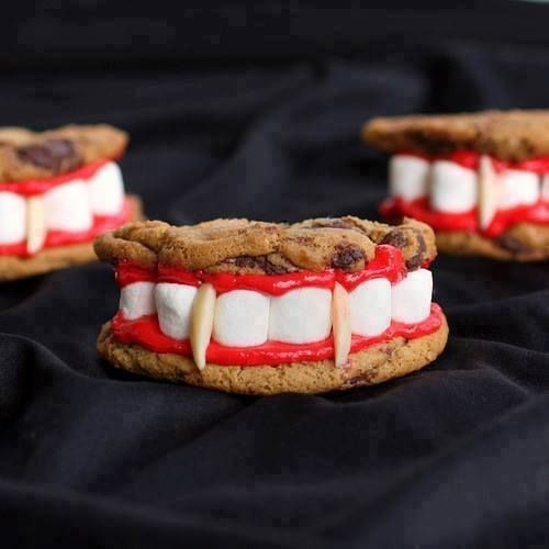 1 package (18.25 ounces) refrigerated chocolate chip cookie dough or your favorite cookie recipe 1/2 cup prepared vanilla frosting, tinted red 1 3/4 cups miniature marshmallows 48 slivered almonds Prepare cookies as directed on package or according to your favorite recipe. Cool on baking sheets for 2 minutes; remove to wire rack to cool completely. Cut each cookie in half for a total of 48 halves.  Frost the bottoms of all cookie halves with frosting.
