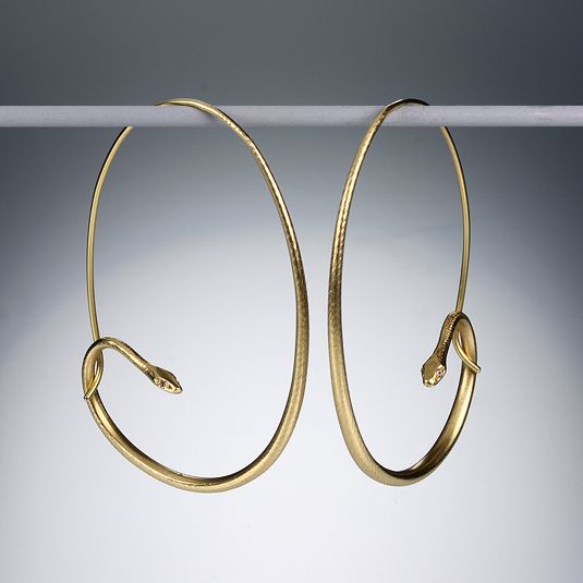 Gabriella Kiss 18K yellow gold large snake hoops with diamond eyes. A MUST have!