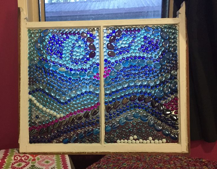 Glass gems glued onto old window