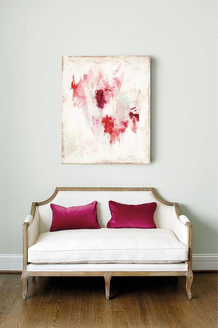 Ballard Designs' Sybil settee with pink, abstract art above it