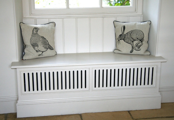 Very quaint and space saving :)     Combined window seat & radiator cover