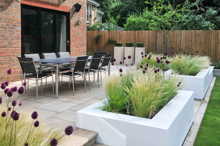 contemporary block planters filled with grasses and allium | Kate Thornton garden design,