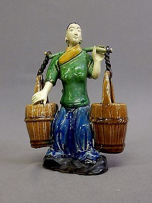 Vintage CHINESE CERAMIC POTTERY FIGURE WITH YOLK, an Asian sculpture / mudman