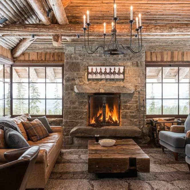 Love the fireplace in this rustic cabin! So cozy.