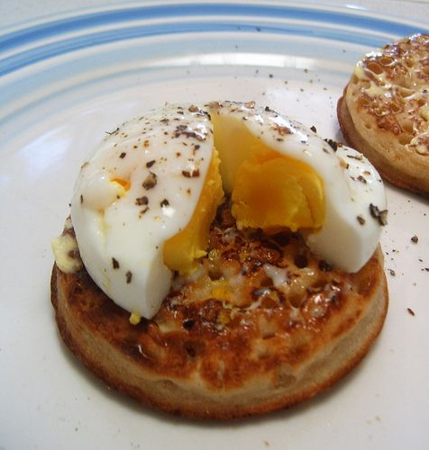 How to Make Crumpets _ Crumpets are mainly eaten in the United Kingdom, though they are also popular in the nations of the Commonwealth. A crumpet is a savoury/sweet bread snack. It was originally a hard pancake cooked on a griddle; but, through the Victorian Era yeast was introduced and they became softer. Later, more baking powder was added to the recipe, creating the typical holes in the crumpet.