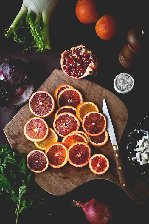The photographer used deep dark colors to give an elegant and rich look to the photo. This effect makes the fruit look even juicier!