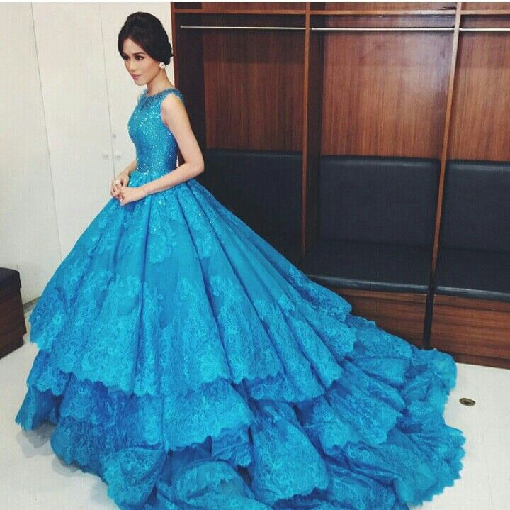 Cinderella gown by Micheal Cinco. Love the design, would want it in a different blue