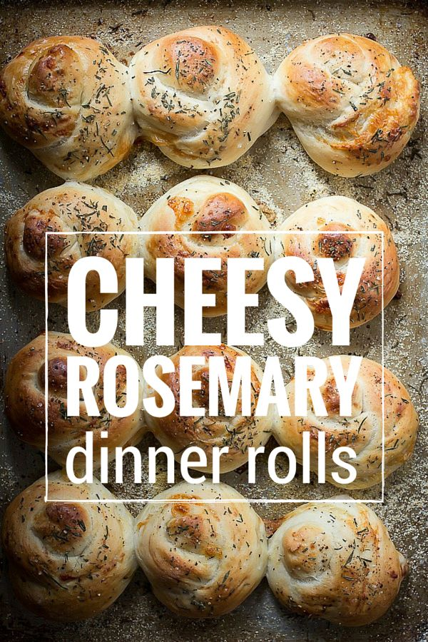 Soft and cheesy dinner rolls topped with sea salt and fresh rosemary. Perfect for Easter dinner | Foodness Gracious