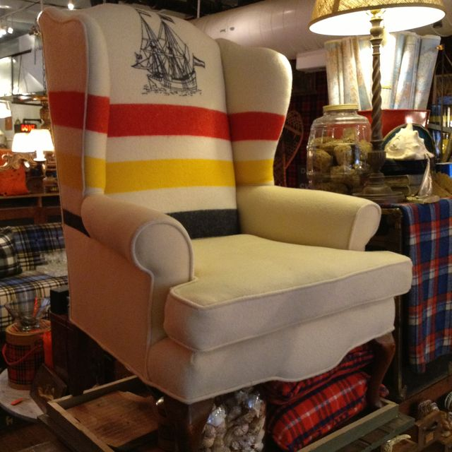 Wingback chair reupholstered in a classic Hudson Bay Blanket
