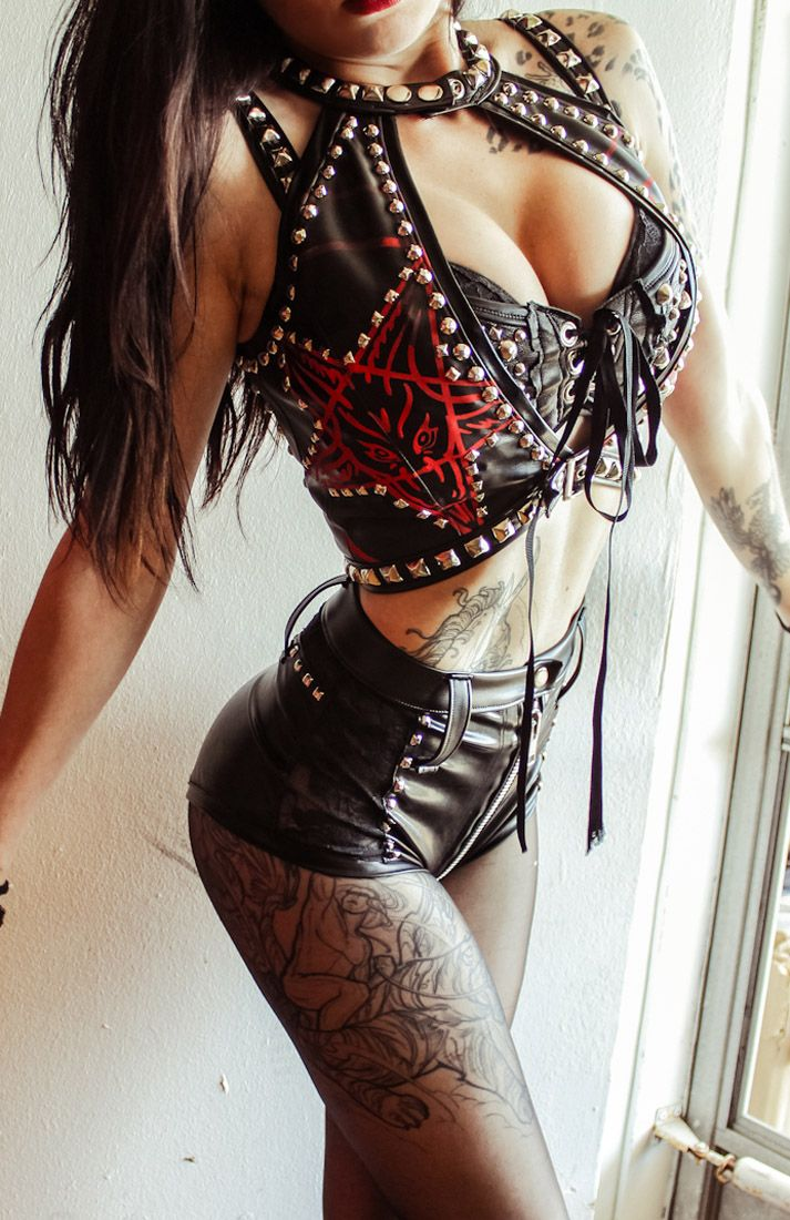 love the bra top and vest..minus the pentagram and just a tad less cleavage ..cuz yea I'm kinda like   'Rock  it!'  but not into the whole 'Lookz like a babies bootie is creepin outta my chest' thing :P
