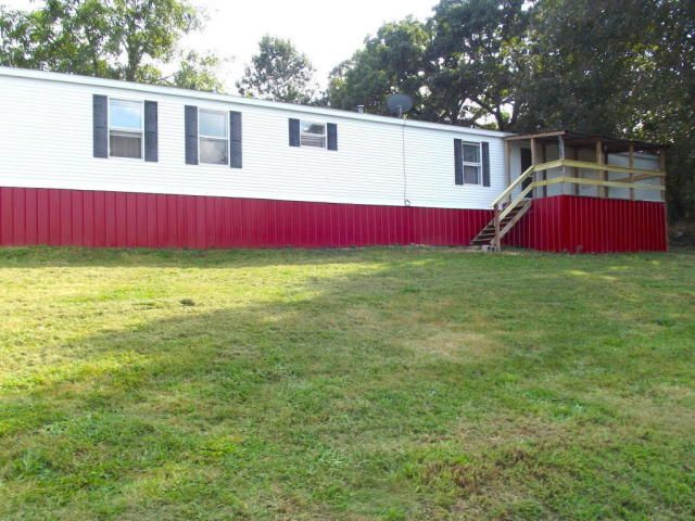 Mobile sitting on large 110x145 lot. Completely remodeled. 16x80 mobile home with new paint inside and out, slate flooring, new carpeting, decorative trim, ceiling fans, and large front deck. Priced to sell @ $29,900. Property located walking distance to library, several restaurants, and dollar store. No reason for a car! This home is also located near the Mark Twain National Forest and Eleven Point Scenic River. Canoe, fish, swim, and hunting is unlimited in Alton MO