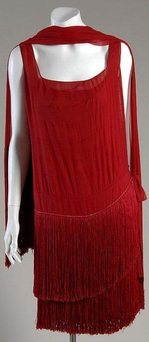 Flapper Dress, circa 1925, House of Chanel, Design by Gabrielle 'Coco' Chanel: Silk chiffon with silk fringe.