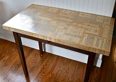 decoupaged table top - I personally appreciate that the crafter used pages from an old etiquette book.