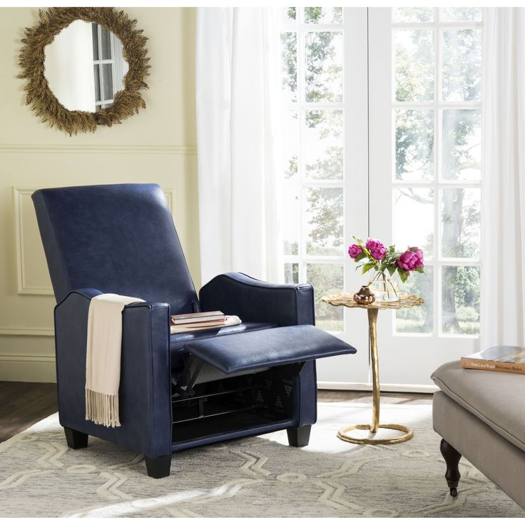 Sit back and relax in style. This navy PU recliner is designed for maximum comfort in smaller homes and apartments.