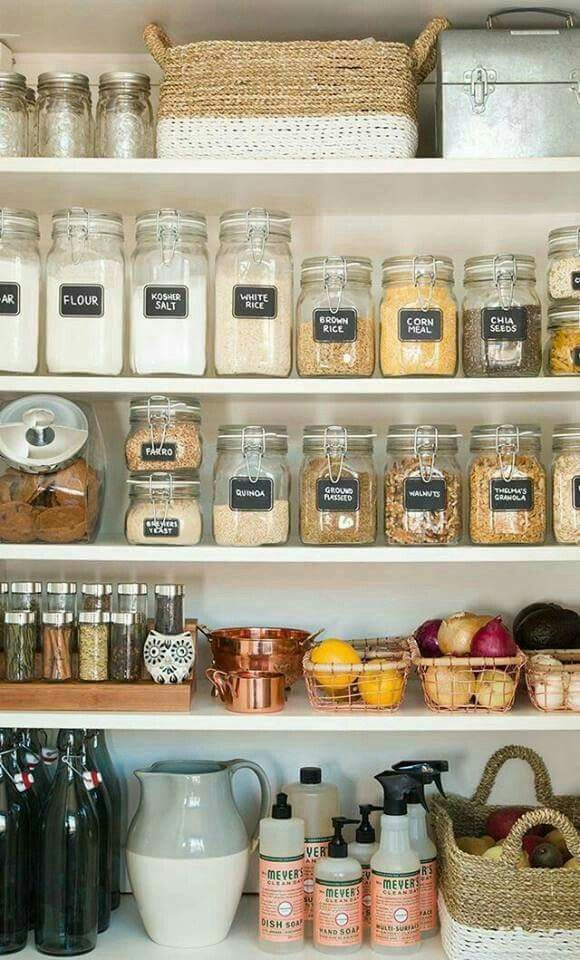 labeled organized pantry with glass jars & storage