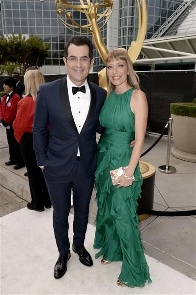 Ty Burrell and wife Holly Anne Brown arrive at the 2014 Emmy Awards at the Nokia Theatre L.A. Live in Los Angeles on Aug. 25, 2014.