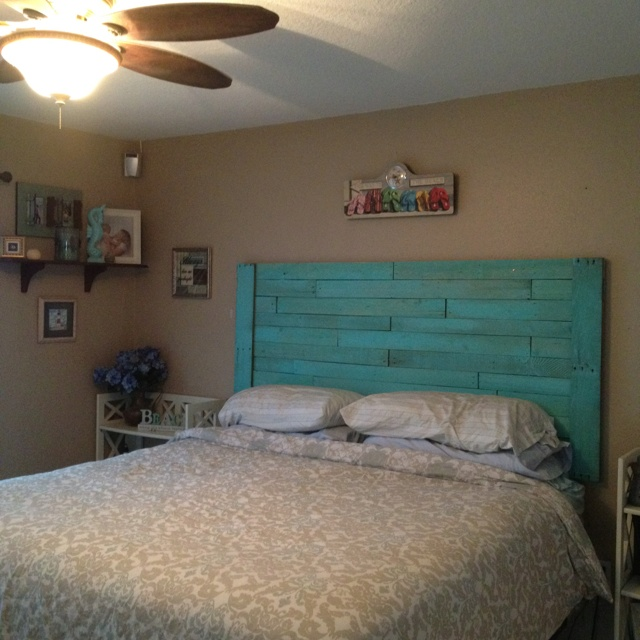 My turquoise pallet headboard...no turquoise for me but may be an interesting way to incorporate yellow....
