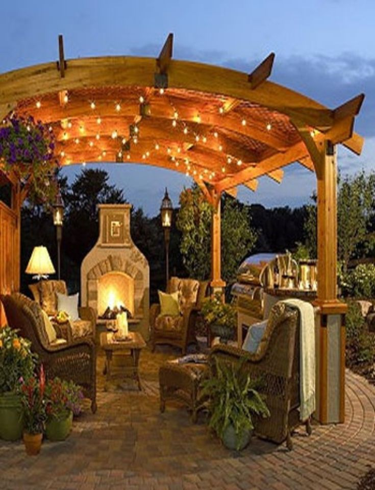 Patio Glow; I love the arch of this pergola!