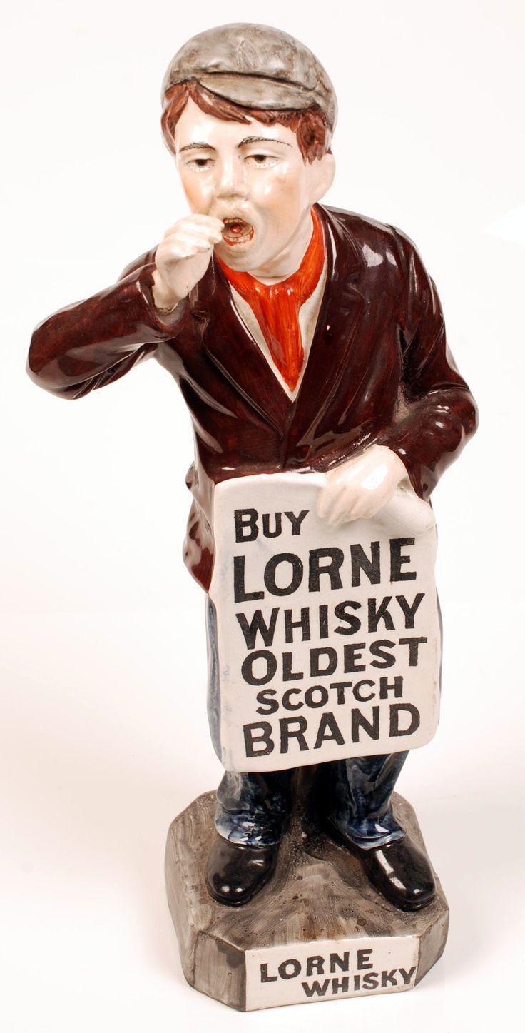 Advertising Figure: Ceramic figure of a boy advertising 'Lorne Whisky - Oldest Scotch Brand'.