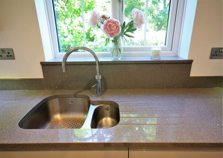 Curved stainless steed under-mounted sink. Goes nicely with the Grey Quartz worktop