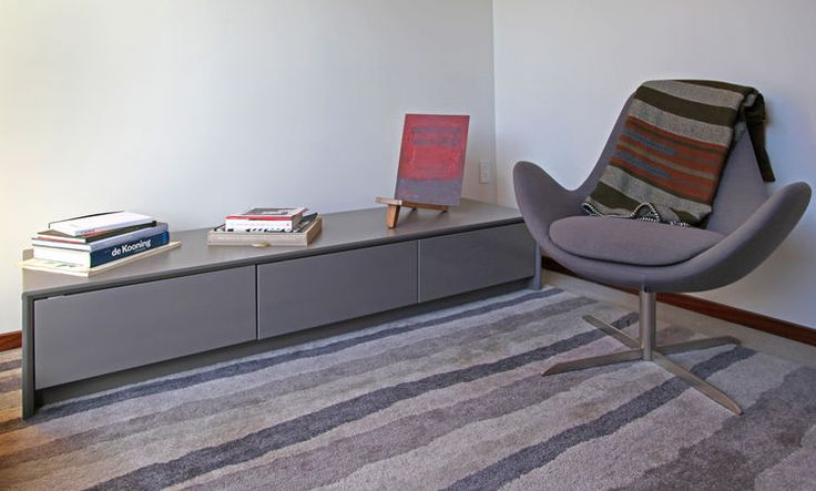 In this series, Sebastian Mariscal designs a home in Venice, California, that brings the outside in.  The Media Room features a Materico fine wool rug, Electa swivel armchair in tigris light grey and Password 3-Drawer unit low credenza in matt taupe from Calligaris.