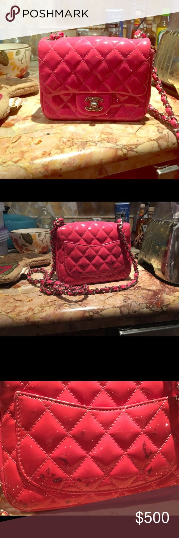 CHANEL Patent Quilted Extra Mini Flap Pink ULTRA RARE AND ABSOLUTELY STUNNING AUTHENTIC CHANEL PINK QUILTED PATENT LEATHER SQUARE MINI FLAP BAG WITH SPARKLING SILVERTONE HARDWARE! This charming mini flap is crafted of glossy diamond quilted patent leather in pink. The bag features a cross body leather shoulder strap threaded with leather and a silver frontal Chanel CC Mademoiselle turn lock that opens the flap to a matching leather interior Bag is in excellent condition except for some black…