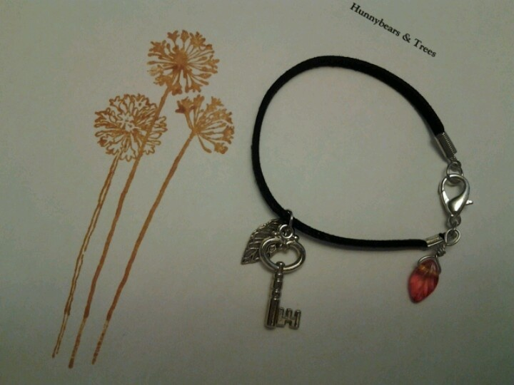 Black leather and charms bracelet by Hunnybears and Trees. Selling on Etsy!