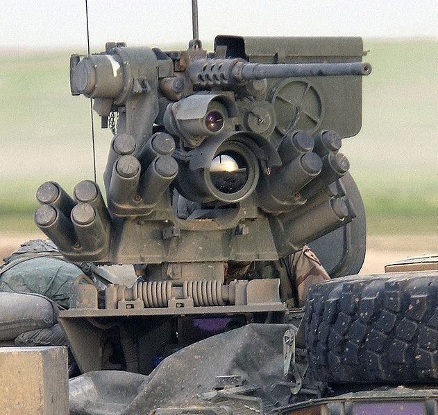 Protector M151 with an M2 heavy machine gun on a M1126 Stryker aka Bug Mecha - ref.MAT ( http://en.wikipedia.org/wiki/Remote_weapon_station )