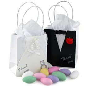 Mini Bride and Groom Favor Bags  http://www.hansonellis.com/bride-groom-wedding-favor-bags.html