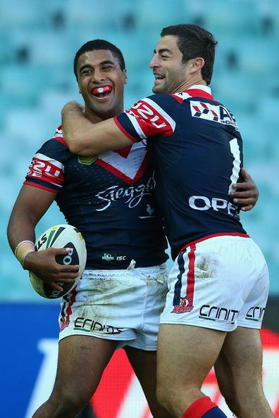 Anthony Minichiello of the Roosters congratulates team mate Michael Jennings of the Roosters after scoring a try during the round eight NRL match between the Sydney Roosters and the Penrith Panthers at Allianz Stadium on May 5, 2013 in Sydney, Australia.