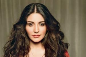 """While the media is going frantic about Aamir-Anushka's """"longest kiss"""" in Rajkumar Hirani' 'P.K.', the pretty actress denies it."""
