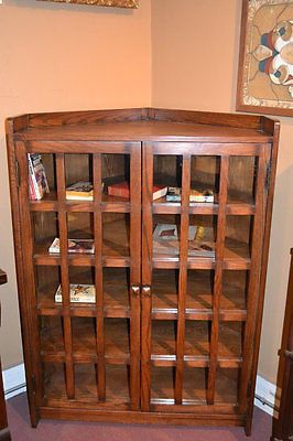 Arts & Crafts Mission Oak Corner Bookcase made with solid Oak. This is a quality reproduction of the 100 year old Stickley piece, which are very rare and when found are usually not in good condition.