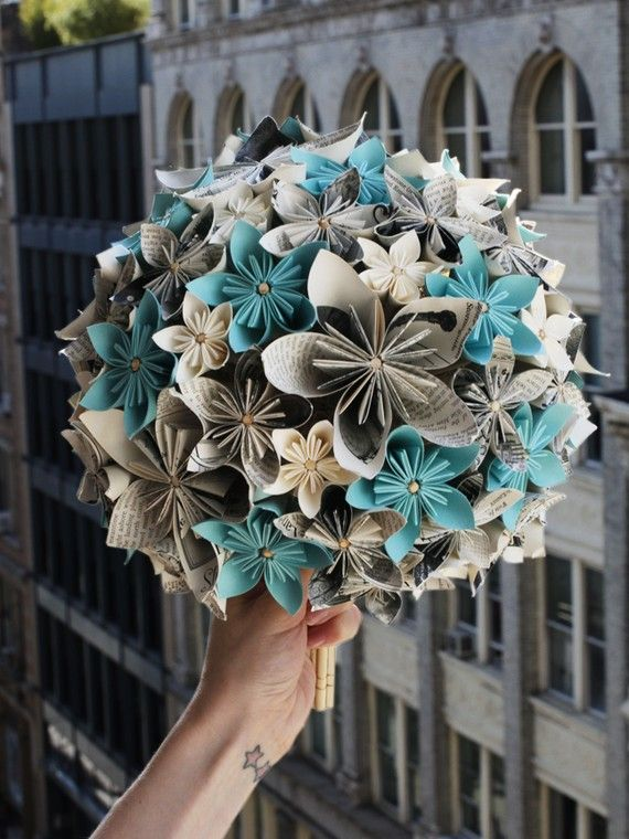 Easy alternative bouquet: origami kusudama flowers in different sizes, attached with skewers (through the center of each flower) to a florist's foam ball-shaped form.  Several skewers in the bottom for 'stems.'