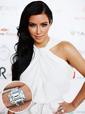 It's Valentine's Day and what better way to celebrate it than Kim Kardashian's huge rock! The marriage didn't last very long but this 20.5 carats in total featuring a 16.5 carat emerald cut center stone flanked by two 2 carat diamonds by Lorraine Schwartz is one ring that'll stay in for the ride. Might be too indulgent for some but this sparkler sure matches her loud, attention-grabbing personality. With a hefty jewel on her finger, she still got the massive booty to match!